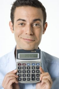 Portrait of businessman holding calculator