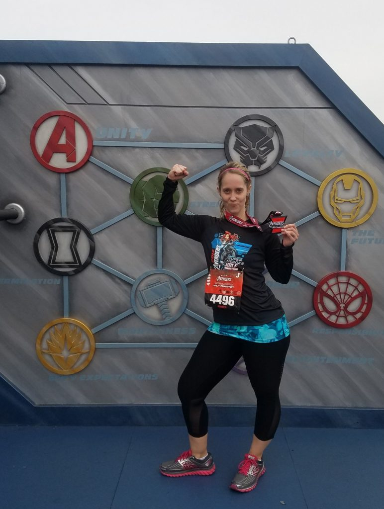 Amber celebrates after completing the Superhero Half Marathon