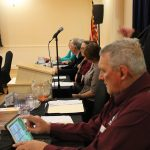 """Re-elected board member William """"Bill"""" DeJager prepares for the meeting"""