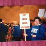 Employee with a sign in the 90s