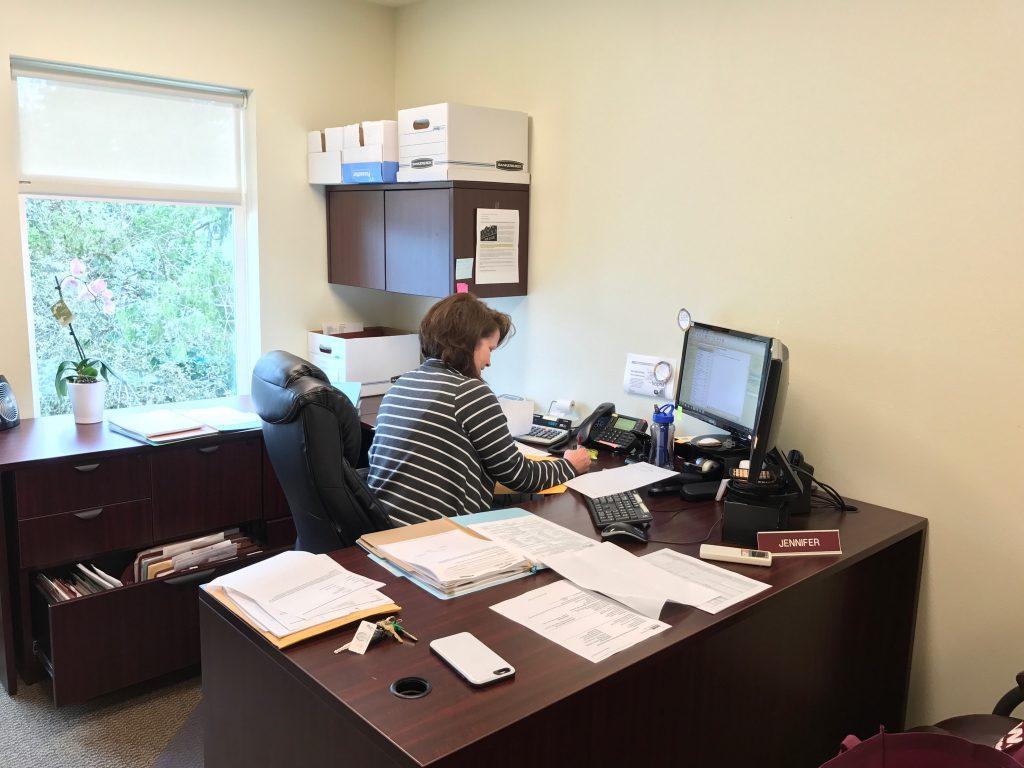 Jen at her desk