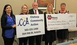 Robert Blumberg, Amy Stocky and Debi Smiley presents a check for $2,543.20 to Elaine Bruce and Viviana Matthews of CCA